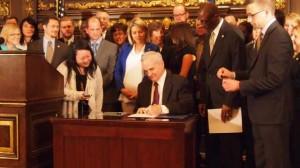 Governor Dayton Signing Law